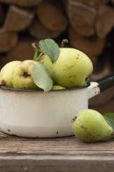 cooking pears in a enamel pot on a wood natural background